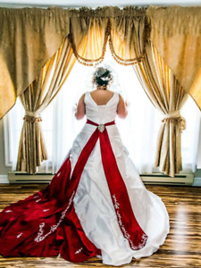 White wedding dress with red accents