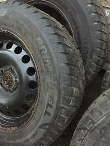 215/65R16 snow tires on Chevy rims  Prince George British Columbia image 2