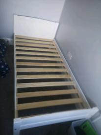 2x white wood single beds without mattress