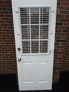 Steel Entry Door with window, hardware. 32 by 80 inches.