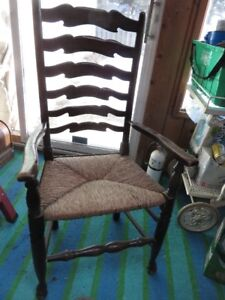 ANTIQUE LADDER BACK CHAIR WITH REED SEAT ASKING $75 OR BEST OFFE
