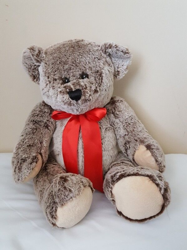 plush toy bear with red ribbon stuffed animals