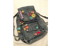 CLAIR'S denim emoji rucksack / backpack with added charm.