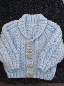 Hand knitted baby Aran jacket