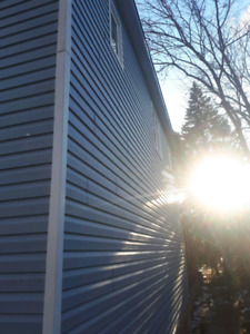 Siding, soffit, fascia and evestroughs.