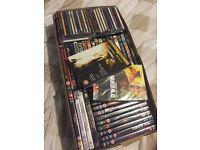 Box of new sealed dvd's/cd's 62