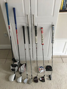 Assorted golf clubs (putters, driver, 3-wood, wedges)