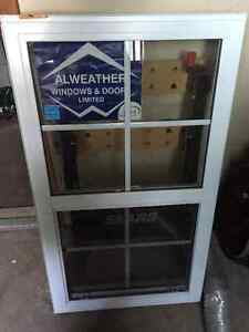 26 x 46 single hung vertical sliding window with a grid pattern