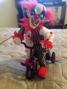 Clown riding a tricycle