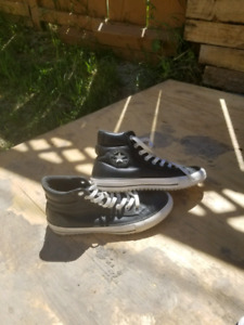 Size 8 and 1/2 Chuck Taylor leather All Stars brand new