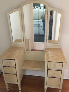 Antique dresser with three mirrors.