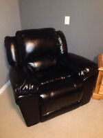 Comfy brand new black leather rocking recliner $600.00