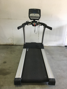 Pre-owned TRUE Fitness LC1100 Treadmill for sale!