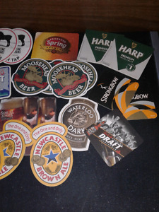 Numerous vintage beer coasters selling as a lot