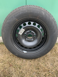 SPARE TIRE NEVER USED.  FROM A VW RABBIT/GOLF.