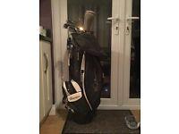 Golf bag and half a set of golf clubs