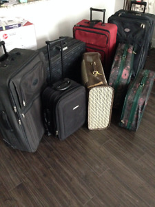 7 Suitcases checked or carry-on Langley