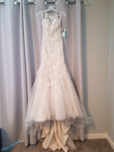 Brand new wedding dress for sale! Price negotiable.