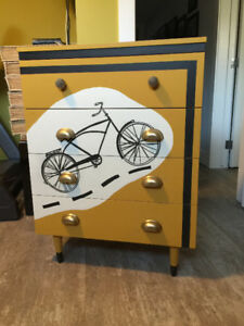 Fun and unique hand painted four drawer dresser