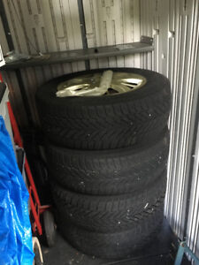 4 Good Year P225/60 R16 winter tires mounted and balanced on