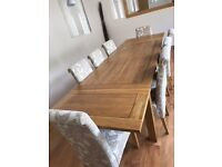 Beautiful new solid oak table and chairs