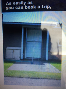 Duplex in country setting but in city limits