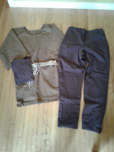 Reenactment costume. Medieval tunic, pants, pouch and belt.