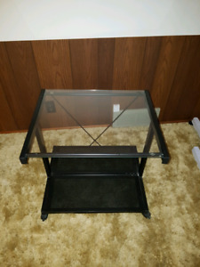 Rolling Glass Toppped Stand.