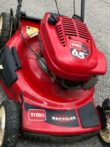 """Toro 22"""" Person Pace lawn mower in Excellent Condition"""