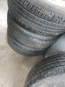 Set of tires and rims from a GMC