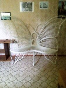 large white metal butterfly shaped decorative corner bench
