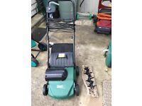 Electric lawn rake/scarifier