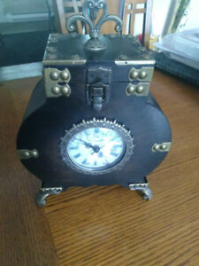 Fully working antique look clock with storage compartment.  $15