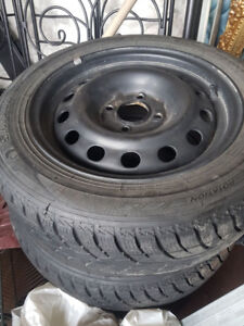 4 snow tires and rims size 185/60R15