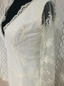 Beautiful wedding gown with lace and long sleeves