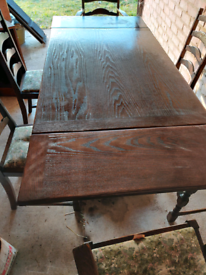 Ercol table with 6 chairs 6-ft long when open 4-ft when closed