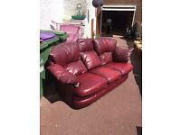 3 seater leather sofa and swivel recliner armchair.