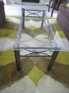 Contemporary Glass Coffee Table with matching End Tables.