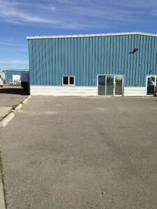 2100 sq ft shop with fenced yard in Airdrie