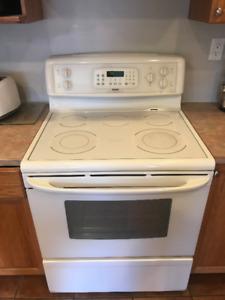 Fridge, oven with range hood, and dishwasher in OSOYOOS