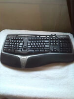 Curved keyboard and docking station for laptop