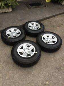 225/75/16 - BRAND NEW tires on Jeep rims.