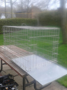 Wire animal cage 24in w x 38in L x25in H excellent condition.