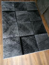 Rug black and grey