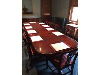 Large table and 12 chairs for sale