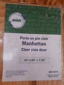 Clear pine interior door.