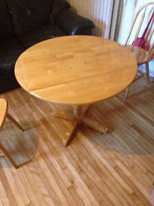 Round Dining Table With Four Matching Chairs