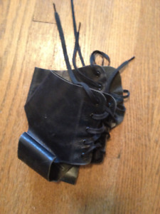 Vintage pair black leather lace-up ankle supports