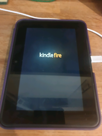 Amazon Kindle Fire with purple flip case