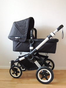 Bugaboo Buffalo stroller with accessories .